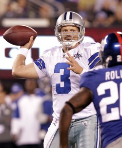Dallas Cowboys Jon Kitna looks to pass at New Meadowlands Stadium in New Jersey