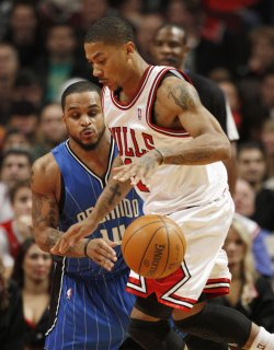 Bulls' Rose dribbles by Magic's Nelson in Chicago