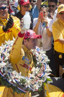 Hunter-Reay drinks milk after win.