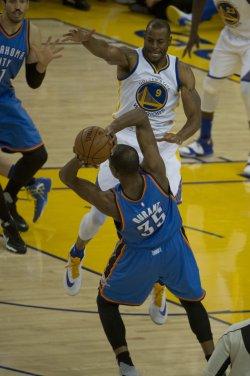 Warriors Andre Iguodala tries to guard OKC Thunder's Kevin Durant