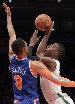 Boston Celtics Jeff Green drives into New York Knicks Jared Jeffries at Madison Square Garden in New York