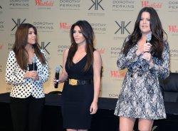 Khloe Kardashian Odom, Kim Kardashian and Kourtney Kardashian attend a photo call in London