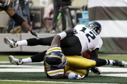 The New York Jets Muhammad Wilkerson sacks Jacksonville Jaguars Luke McCown at MetLife Stadium in New Jersey