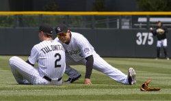Rockies Tulowitzki and Gonzalez Stretch in Denver