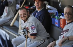 Twins' Kubel laughs in dugout against White Sox in Chicago