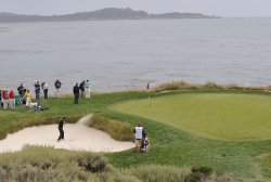 Padraig Harrington of Ireland hits out of the sand on the 7th hole at the U.S. Open in Pebble Beach, California