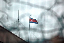 The North Korean flag flies outside its embassy in Beijing