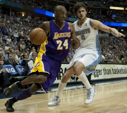 Lakers Bryant Drives Against Nuggets Gallinari During the NBA Western Conference Playoffs First Round Game Six in Denver