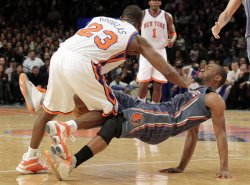 Charlotte Bobcats Kemba Walker is fouled by New York Knicks Toney Douglas at Madison Square Garden in New York