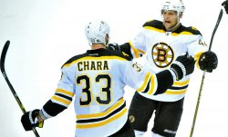 Bruins' Zdeno Chara is congratulated by teammates in Washington