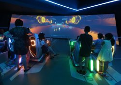 Chinese race on the Tron video game in Shanghai Disneyland, China