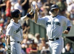 Seattle Mariners' Russell Branyan (R) high fives Jack Hannahan after scoring on Franklin Gutierrez's single to center field against the New York Yankees in the fifth inning at SAFECO Field in Seattle.