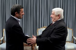 Iranian President Mahmoud Ahmadinejad meets with Syrian Foreign Minister Walid al-Moallem in Tehran, Iran
