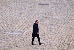 Hollande arrrives at a ceremony honoring victims of recent terrorist attacks in Paris