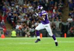 Viking's Adrian Peterson scores a touchdown
