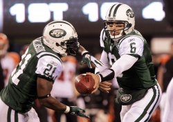 New York Jets Mark Sanchez hands the ball off to LaDainian Tomlinson at New Meadowlands Stadium in New Jersey