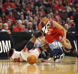 Bulls' Hamilton kicks 76ers' Turner during Playoff in Chicago