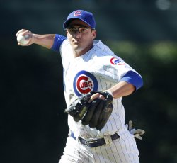 Cubs Baker throws out Reds Phillips in Chicago