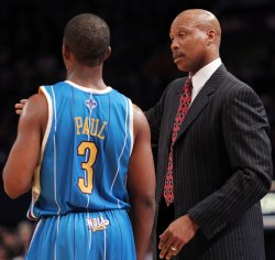 New Orleans Hornets head coach Byron Scott and Chris paul talk during a time out in the second half against the New York Knicks at Madison Square Garden in New York