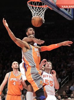 Phoenix Suns Grant Hill gets hit by New York Knicks Jared Jeffries as he drives to the basket at Madison Square Garden in New York