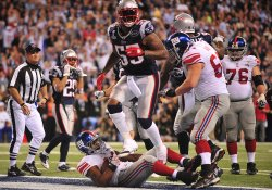 The Giants Bradshaw Scores the Gme-Winning Touchdown Against the Patriots during Super Bowl XLVI in Indianapolis