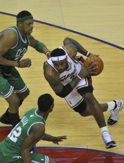 Cavaliers James drives against Celtics in Cleveland
