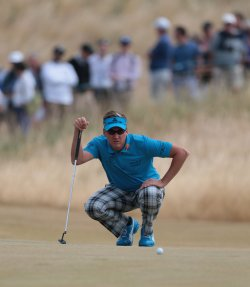 ian Poulter lines up a putt on the 7th green at the Open Championship