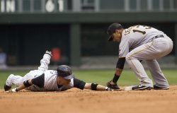 Pirates Cedeno Tags Out Rockies Barmes on Stolen Base Attempt in Denver