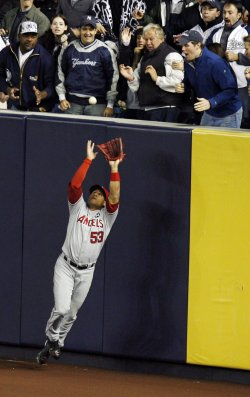 Los Angeles Angels of Anaheim Bobby Abreu makes a catch in the third inning of game 6 of the ALCS against the New York Yankees at Yankee Stadium in New York