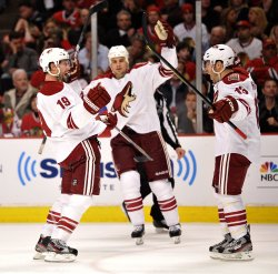 Coyotes Doan and Whitney celebrate goal in Chicago