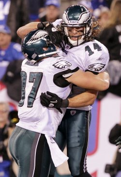 Philadelphia Eagles Riley Cooper reacts with Brent Celek at MetLife Stadium in New Jersey
