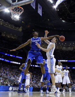 Kentucky Wildcats Terrence Jones blocks a shot from North Carolina Tar Heels Tyler Zeller at the NCAA East Regional Round of 8 at the Prudential Center in New Jersey