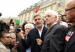 Actor George Clooney takes part in rally against Sudan in Washington DC