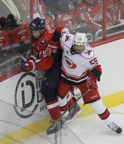 Hurricanes Chad LaRose hits Capitals Jeff Schultz in Washington D.C.