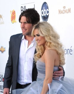 NHL player Mike Fisher and singer Carrie Underwood arrive at the 2012 Billboard Music Awards in Las Vegas, Nevada