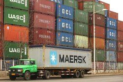 Chinese drivers transport shipping containers in Tianjin's port in China