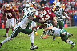Redskins tight end Fred Davis is sent air born in Washington