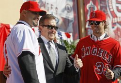 Los Angeles Angels' Albert Pujols, owner Arte Moreno, and pitcher C.J Wilson as they are introduced to the media in Anaheim, California