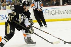 Penguins Matt Cooke Takes Shot on Goal in Pittsburgh