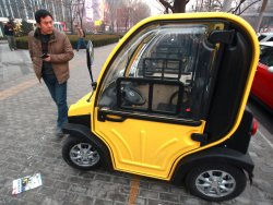 Small, electric cars are sold in Beijing