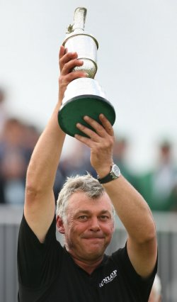 Darren Clarke lifts the claret jug after winning the Open Championship in England.