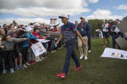 Rickie Fowler walks to the 12th hole during a Ryder Cup Practice Round
