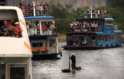 Tourists take cruise down Li River in Guilin