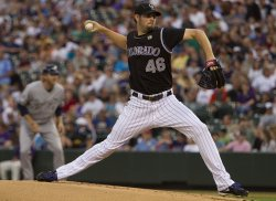 Rockies Pitcher Hammel Throws Against the Brewers in Denver