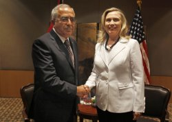 Palestinian Prime Minister Fayyad shakes hands with U.S. Secretary of State Clinton in Jerusalem