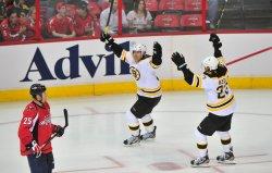 Bruins' Brian Rolston celebrates after scoring in Washington