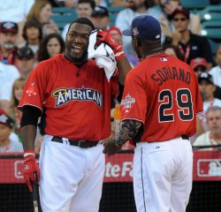 David Ortiz gets a towel from Rafael Soriano during the Home Run Derby in Anaheim, California