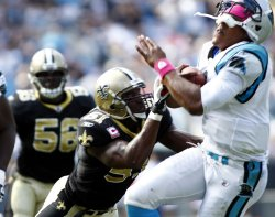 Carolina Panthers quarterback Cam Newton tackled by New Orleans Saints linebacker Jonathan Vilma
