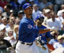 Chicago Cubs' Derrek Lee hits an RBI double against the Houston Astros