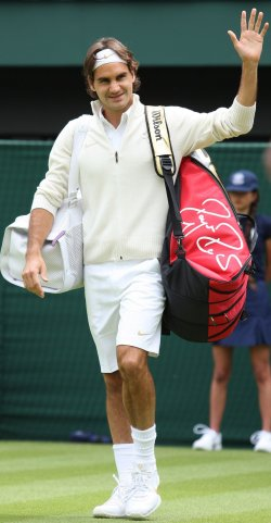 Roger Federer waves to the crowd on the first day of Wimbledon 2010